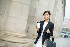 Young business woman walking outside Royalty Free Stock Images