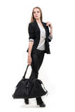 Young business woman walking with travel bag Royalty Free Stock Photos