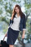 Young business woman walks at camera Stock Image