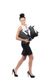 Young business woman walks with several files Royalty Free Stock Photo