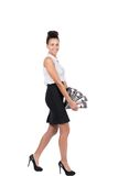 Young business woman walks with several files Royalty Free Stock Photography