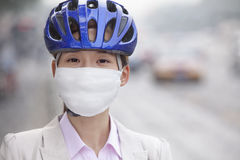Young Business Woman Wearing Bicycle Helmet and Face Mask Royalty Free Stock Image