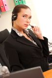 Young business woman wearing headphones Stock Image