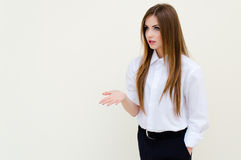 Young business woman wearing man's shirt presenting copyspace Royalty Free Stock Photo