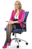 Young Business Woman Wearing Pink Sitting in an Office Chair Stock Images