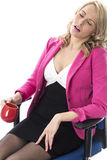Young Business Woman Wearing Pink and Sitting in an Office Chair Holding A Mug Stock Photos