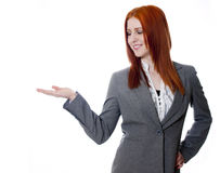 Young business woman on white background, hand out, palm up Stock Photography