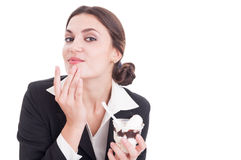 Young business woman wipping her chin after eating ice cream Royalty Free Stock Photography