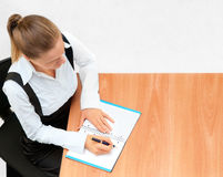 Young business woman while at work. Offce and business Stock Photography