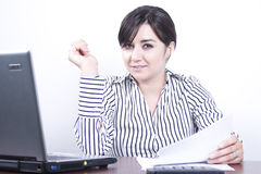 Young business woman at work. Isolated in white background Stock Images