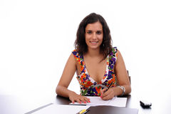 Young business woman at work. Isolated in white background Royalty Free Stock Photos