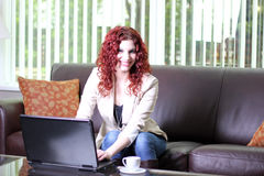 Young business woman at work with laptop computer. Attractive woman at the office working on a laptop computer Royalty Free Stock Image