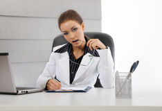 Young business woman working. With documents stock images