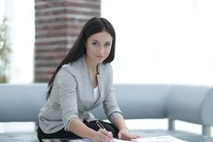 Business woman working with documents in the office Stock Photos