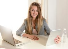 Young Business Woman working on her Laptop Stock Photos