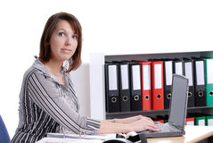 Young business woman working in her office. Wall of files Royalty Free Stock Images