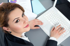 Young business woman working at her office Royalty Free Stock Photo