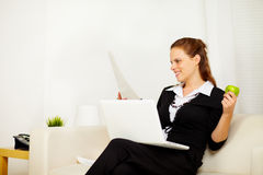 Young business woman working at home Stock Photos