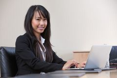 Young business woman working on laptop Stock Photos