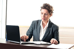 Young business woman working on laptop Royalty Free Stock Photo