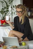 Young  business woman working on laptop in her home office. Stock Photos