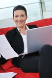 Young business woman working on laptop at home Royalty Free Stock Photos
