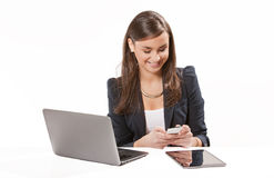 Young business woman working on laptop. Royalty Free Stock Photography