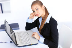 Young business woman working on laptop in office Stock Photos