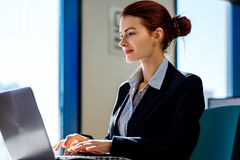 Business woman working on laptop in the office. royalty free stock photos