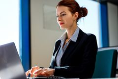 Business woman working on laptop in the office. royalty free stock photo