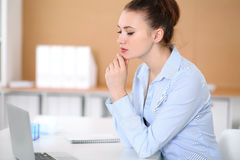 Young business woman working on laptop in office. Successful business concept. Young business woman working on laptop in office. Successful business concept Royalty Free Stock Image