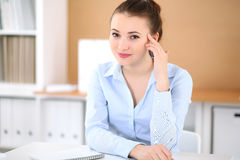 Young business woman working on laptop in office. Successful business concept. Young business woman working on laptop in office. Successful business concept Royalty Free Stock Images