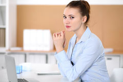 Young business woman working on laptop in office. Successful business concept. Young business woman working on laptop in office. Successful business concept Royalty Free Stock Photo