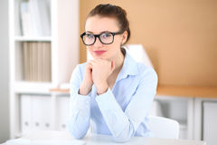 Young business woman working on laptop in office. Successful business concept. Young business woman working on laptop in office. Successful business concept Stock Photography