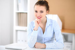 Young business woman working on laptop in office. Successful business concept. Young business woman working on laptop in office. Successful business concept Stock Photos