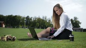Young business woman working on laptop outdoor stock video