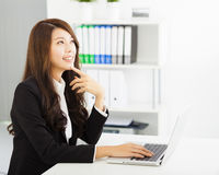 Young business woman working with  laptop Royalty Free Stock Images