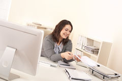 Young business woman working at office Stock Image