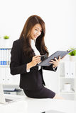 Young business woman working with  in office Stock Photo