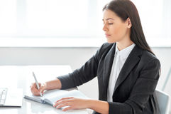 Young business woman working in the office stock photography