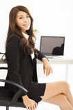 Young business woman working in the office Stock Image