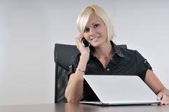 Young business woman working in office on laptop Royalty Free Stock Images