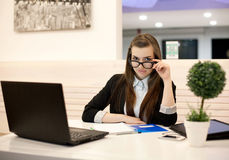 Young business woman working in the office with a laptop Stock Image