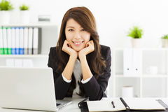 Young business woman working in the office. Smiling young business woman working in the office Stock Photo