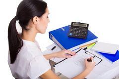 Young business woman working at office, writing Royalty Free Stock Images