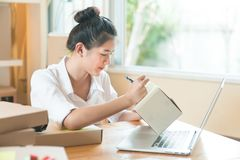 Young business woman working online shopping at her home.  Royalty Free Stock Photography