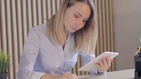 Young business woman working at shared desk in trendy hipster start up office using big data on laptop computer. Young business woman working at shared desk in stock footage