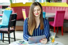 Young business woman working on a tablet. The concept of work, b. Usiness, education, freelance, lifestyle Royalty Free Stock Image