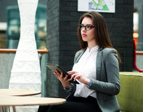 Young business woman working with the tablet in office Royalty Free Stock Image