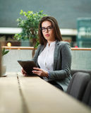 Young business woman working with the tablet in office Stock Images